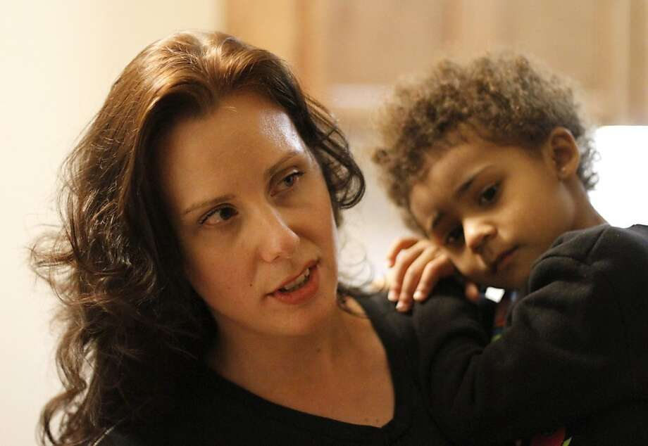 Ana Sanders, a mother of six who works as a medical assistant and is studying to be a nurse, holds 3-year-old daughter U'nique. Photo: Sean Culligan, The Chronicle