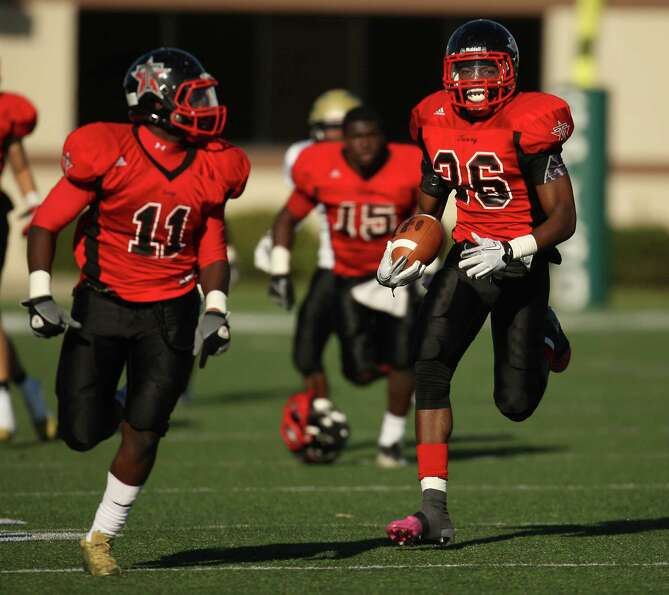 Terry's Victor Davis (26) runs back an interception 75 yards for the game-winning touchdown during t