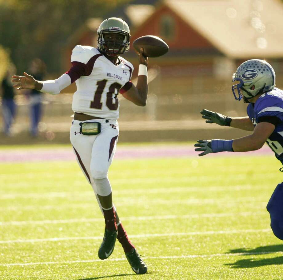 Summer Creek High School quarterback 	Aaron Sharp looks for an open receiver during the first quarter of a Class 4A Division I area round playoff game, Saturday, Nov. 24, 2012, in College Station. Photo: Nick De La Torre, Houston Chronicle / © 2012  Houston Chronicle