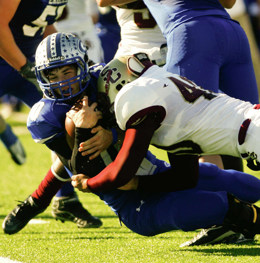 Georgetown High School quarterback Jake Hubenak is tackled by Summer Creek's Dakota Allen during the second quarter of a Class 4A Division I area round playoff game, Saturday, Nov. 24, 2012, in College Station. Photo: Nick De La Torre, Houston Chronicle / © 2012  Houston Chronicle