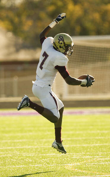 Summer Creek receiver Gregory Hogan comes down with a high pass for a first downquarter of a Class 4