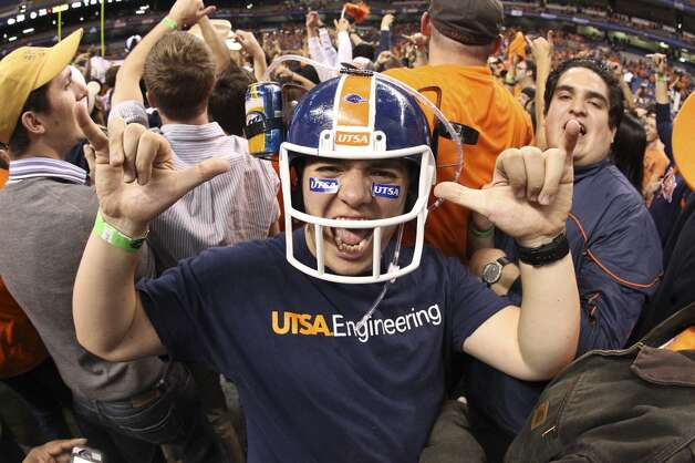 A UTSA student celebrates on the field after the game against Texas State at the Alamodome on Saturday, Nov. 24, 2012. The Roadrunners defeated the Bobcats 38-31. (Kin Man Hui / San Antonio Express-News)