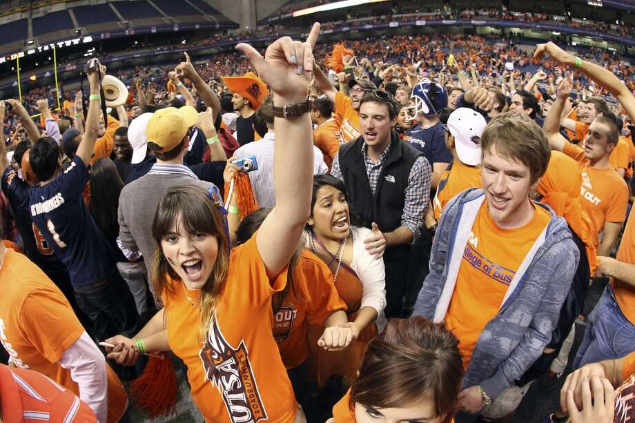 UTSA fans celebrate on the field after the game against Texas State at the Alamodome on Saturday, Nov. 24, 2012. The Roadrunners defeated the Bobcats 38-31. (Kin Man Hui / San Antonio Express-News)