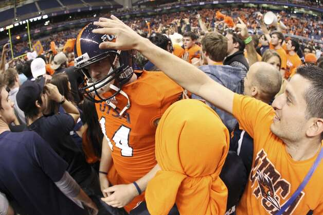 UTSA's Travis Menn gets a pat on the helmet by a fan after their game against Texas State at the Alamodome on Saturday, Nov. 24, 2012. The Roadrunners defeated the Bobcats 38-31. (Kin Man Hui / San Antonio Express-News)