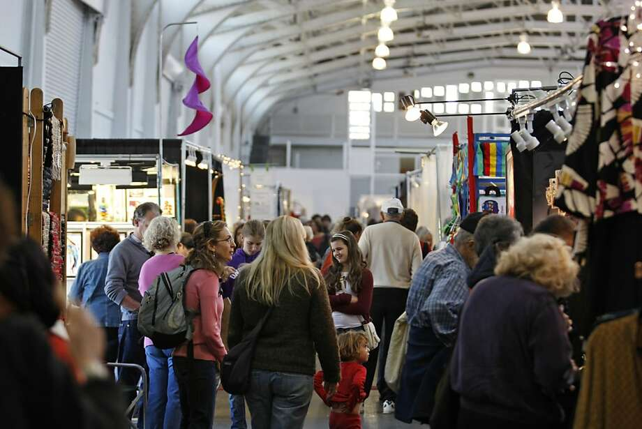 Shoppers stroll through the annual Craftswomen Holiday Crafts Show, which features 200 vendors. The show continues Sunday and next weekend at Fort Mason Center. Photo: Rashad Sisemore, The Chronicle
