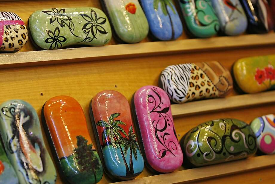 Angie Witt-Thompson's unique hand painted eyeglass leather cases are available for sale from her booth, ByAngie, at The Fort Mason Center in San Francisco, Calif. for the 34th annual Craftswomen Holiday fair. The works of female artists and craftwomen are being sold in a benefit for the city's Women's Building and its programs. Photo: Rashad Sisemore, The Chronicle