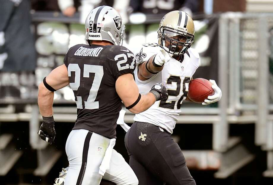 The Raiders' defense, which includes safety Matt Giordano, is one of the NFL's worst, as the Saints' Mark Ingram pointed out last Sunday while scoring. Photo: Thearon W. Henderson, Getty Images