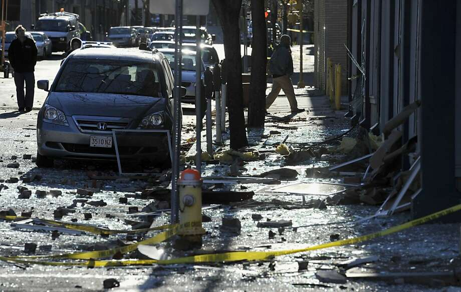 Debris clutters the sidewalk and street a block away from the site of a blast that leveled a strip club in Springfield, Mass. Photo: Jessica Hill, Associated Press