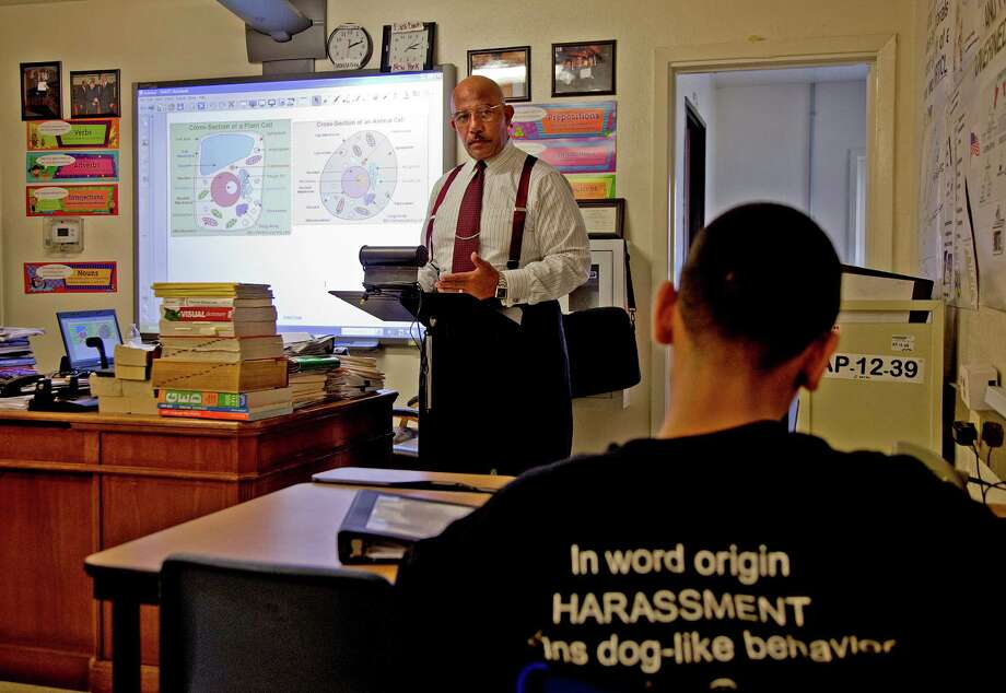 """William Lee teaches science to students at the Harris County Juvenile Probation Department charter school and GED program for youths in detention. """"We want them to focus on academics,"""" says the teacher, who asserts a calm authority in the class. Photo: Thomas B. Shea / © 2012 Thomas B. Shea"""