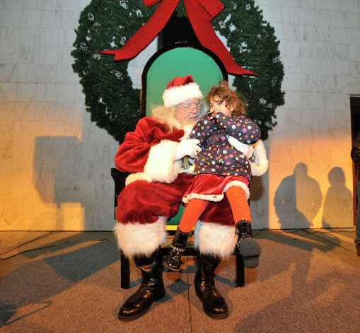 Alisa Mabrouk, 4, of Danbury, sits with Santa during the Light the Lights holiday celebration at Library Plaza in Danbury on Saturday, Nov. 24, 2012. Photo: Jason Rearick / The News-Times