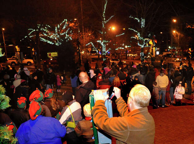 Mayor Mark Boughton flips the switch, illuminating the trees in Library Plaza in Danbury during the Light the Lights holiday celebration on Saturday, Nov. 24, 2012. Photo: Jason Rearick / The News-Times