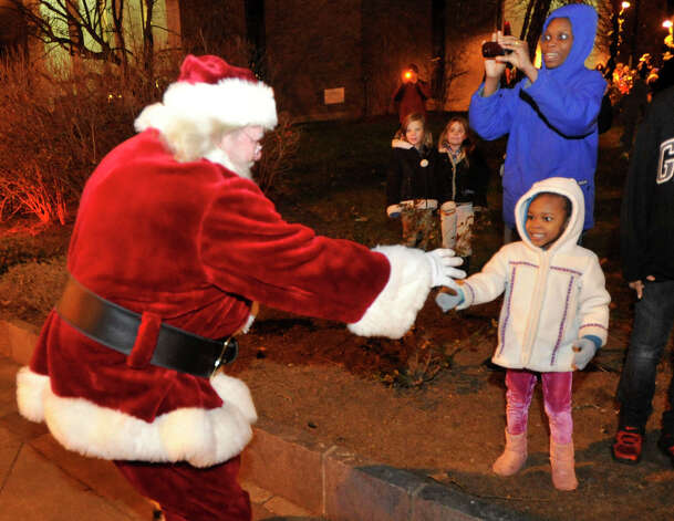 Santa greets Diana Adebambo during the Light the Lights holiday celebration at Library Plaza in Danbury on Saturday, Nov. 24, 2012. Photo: Jason Rearick / The News-Times