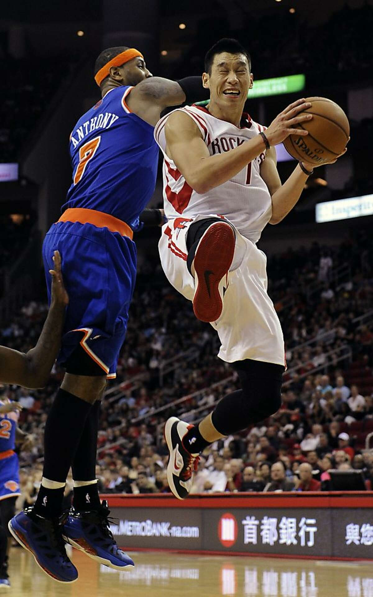 Houston Rockets' Jeremy Lin, right, goes to the basket as New York Knicks' Carmelo Anthony, left, tries to stop him in the second half of an NBA basketball game, Friday, Nov. 23, 2012, in Houston. (AP Photo/Pat Sullivan)