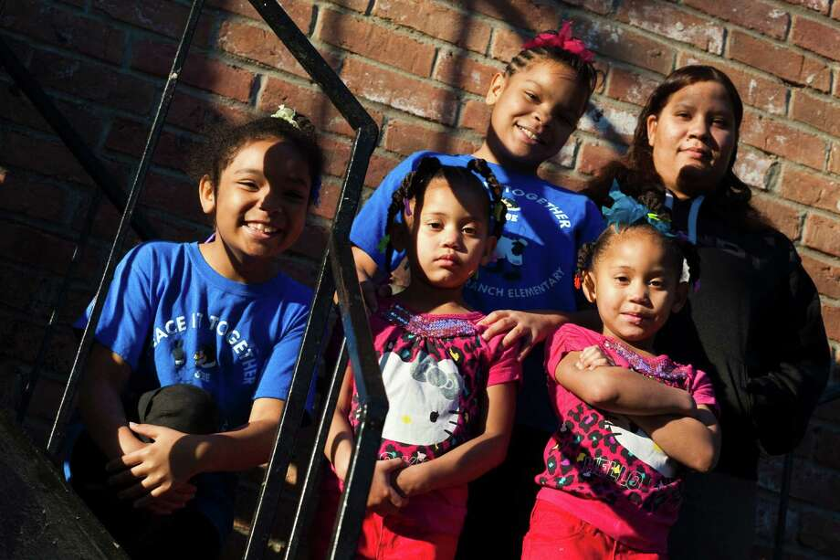 The Fisher family, from left, Brianna, 8, Brittany, 10, Laurie and Lauren, 5, and mother Latanya, in Houston. Photo: Eric Kayne / © 2012 Eric Kayne