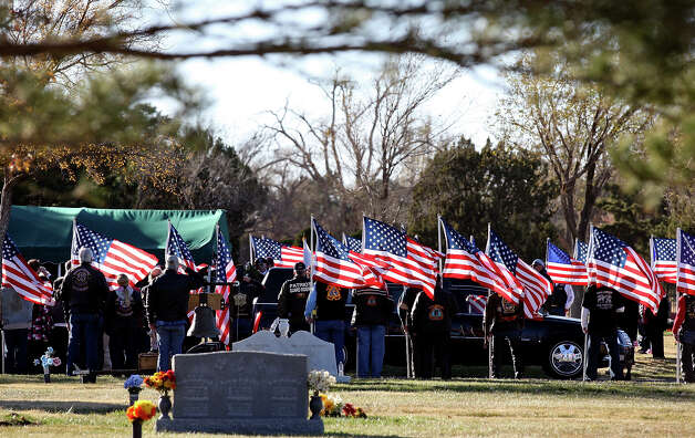 People attend the graveside service for retired Army Sgt. Joshua Michael at Llano Cemetery in Amarillo. Michael, who had been living in the San Antonio area, was one of four war veterans killed in the Midland train wreck. Photo: Edward A. Ornelas, San Antonio Express-News / © 2012 San Antonio Express-News