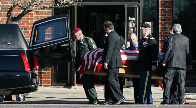 The flag-draped casket of retired Army Sgt. Joshua Michael is moved to a hearse after the funeral service at Cornerstone Church Saturday Nov. 24, 2012 in Amarillo, Tx. Michael was one of four veterans killed when a train struck a parade float he and his wife Daylyn Michael (not pictured) and others were riding on Thursday Nov. 15, 2012 in Midland, Tx. Photo: Edward A. Ornelas, San Antonio Express-News / © 2012 San Antonio Express-News