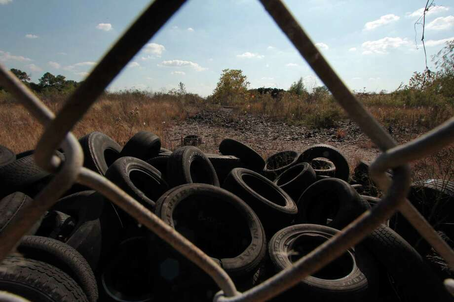It's illegal to dump tires, but they can be found in heaps across Texas. This site on Old Genoa Red Bluff Road, in southeast Houston, holds more than 800,000 tires. Photo: James Nielsen, Staff / © Houston Chronicle 2012
