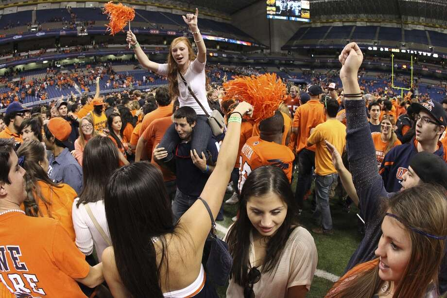 UTSA fans take the field after the Roadrunners defeated Texas State at the Alamodome on Saturday, Nov. 24, 2012. The Roadrunners defeated the Bobcats 38-31. (Kin Man Hui / San Antonio Express-News)