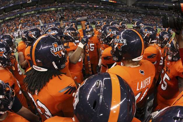 The UTSA Roadrunners gather at midfield before their game against Texas State in the first half of their game at the Alamodome on Saturday, Nov. 24, 2012. (San Antonio Express-News)