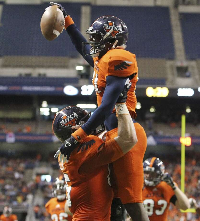 UTSA's Kenny Bias celebrates a touchdown with teammate Jeremiah Moeller (85) against Texas State in the first half of their game at the Alamodome on Saturday, Nov. 24, 2012. (Kin Man Hui / San Antonio Express-News)