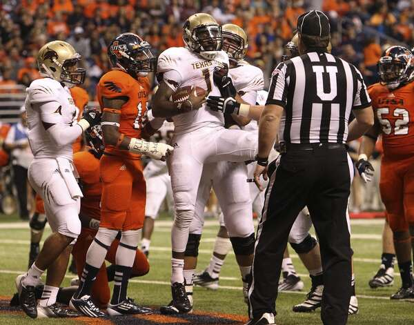 Texas State quarterback Shaun Rutherford (17) celebrates a touchdown against UTSA in the first half of their game at the Alamodome on Saturday, Nov. 24, 2012. (Kin Man Hui / San Antonio Express-News)