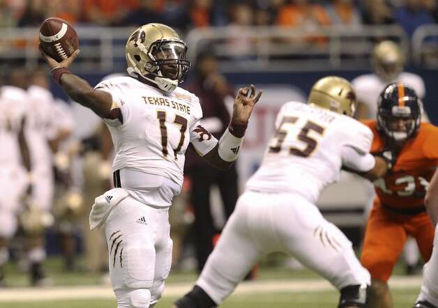 Texas State's Shaun Rutherford (17) attempts a pass in the first half of their game at the Alamodome on Saturday, Nov. 24, 2012. (Kin Man Hui / San Antonio Express-News)