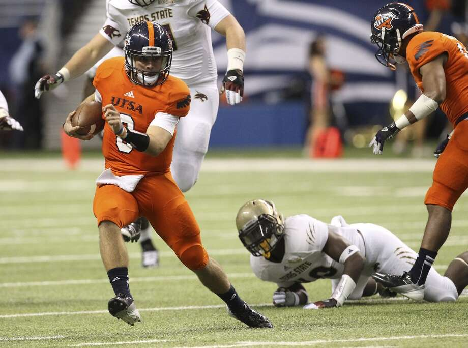 UTSA's Eric Soza scrambles for yardage against Texas State in the first half of their game at the Alamodome on Saturday, Nov. 24, 2012. (Kin Man Hui / San Antonio Express-News)