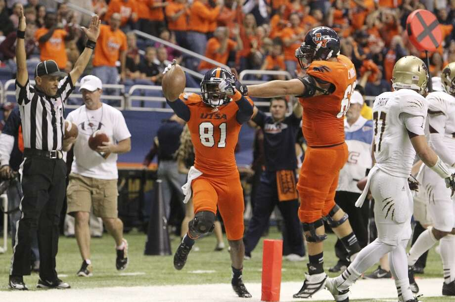 UTSA's Kenny Bias (81) celebrates a touchdown with teammate Cody Harris (68) against Texas State in the first half of their game at the Alamodome on Saturday, Nov. 24, 2012. (Kin Man Hui / San Antonio Express-News)