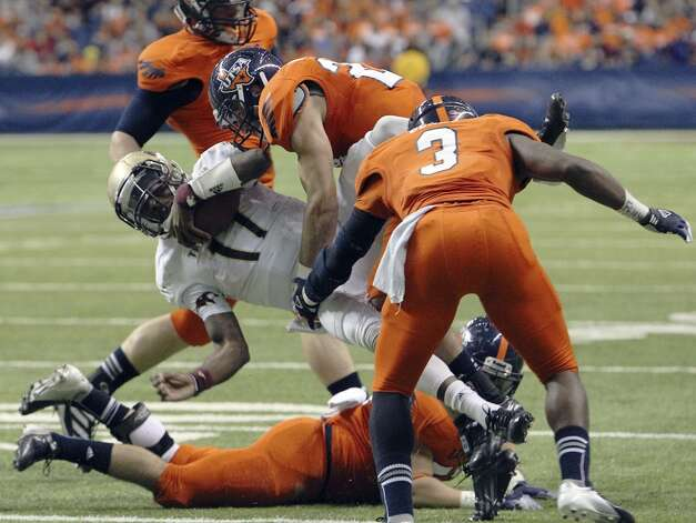 UTSA's Nic Johnson (22) puts a big tackle on Texas State quarterback Shaun Rutherford (17)in the first half of their game at the Alamodome on Saturday, Nov. 24, 2012. (Kin Man Hui / San Antonio Express-News)