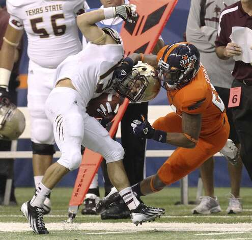 UTSA's Darrien Starling (24) makes a tackle against Texas State's Andy Erickson (13) in the first half of their game at the Alamodome on Saturday, Nov. 24, 2012. (Kin Man Hui / San Antonio Express-News)