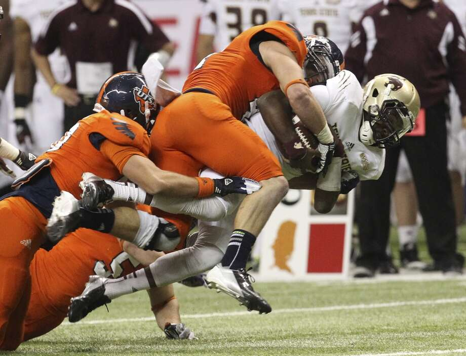 UTSA's Steven Kurfehs (44) makes a tackle on Texas State quarterback Shaun Rutherford (17) in the second half of their game at the Alamodome on Saturday, Nov. 24, 2012. The Roadrunners defeated the Bobcats 38-31. (Kin Man Hui / San Antonio Express-News)