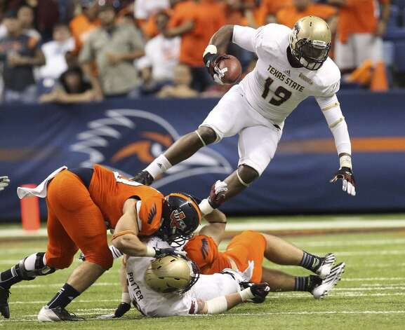 Texas State's Chase Harper (19) goes airborne against UTSA in the second half of their game at the Alamodome on Saturday, Nov. 24, 2012. The Roadrunners defeated the Bobcats 38-31. (Kin Man Hui / San Antonio Express-News)