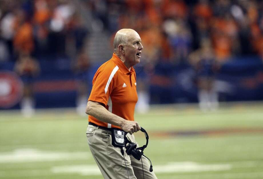 UTSA head coach Larry Coker directs his team from the sidelines against Texas State in the second half of their game at the Alamodome on Saturday, Nov. 24, 2012. The Roadrunners defeated the Bobcats 38-31. (Kin Man Hui / San Antonio Express-News)