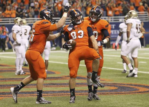 UTSA's Cole Hubble (83) celebrates a touchdown with teammates Jeremiah Moeller (85) and Cole Hicks (80) against Texas State in the first half of their game at the Alamodome on Saturday, Nov. 24, 2012. (Kin Man Hui / San Antonio Express-News)