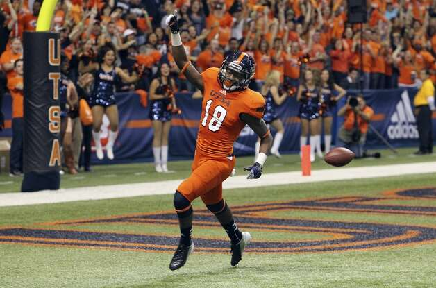 UTSA's Kenny Harrison reacts after running in a 79-yard punt return for a touchdown against Texas State in the first half of their game at the Alamodome on Saturday, Nov. 24, 2012. (Kin Man Hui / San Antonio Express-News)