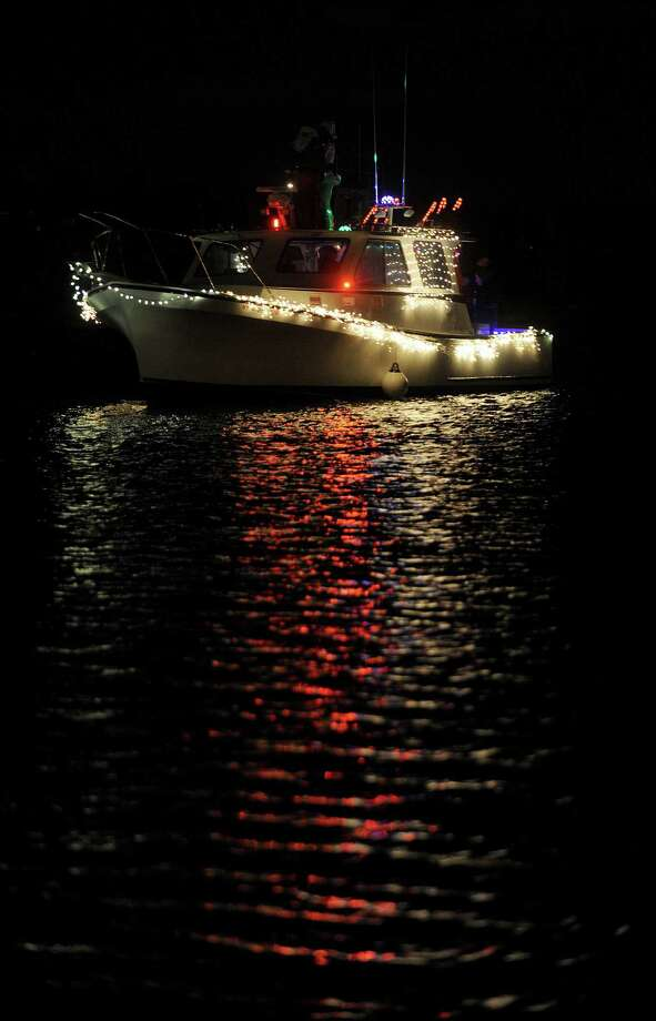 Decorated boats make their way to Stamford Landing from Czesick Marina as part of the annual boat parade on Saturday, November 24, 2012. Photo: Lindsay Niegelberg / Stamford Advocate