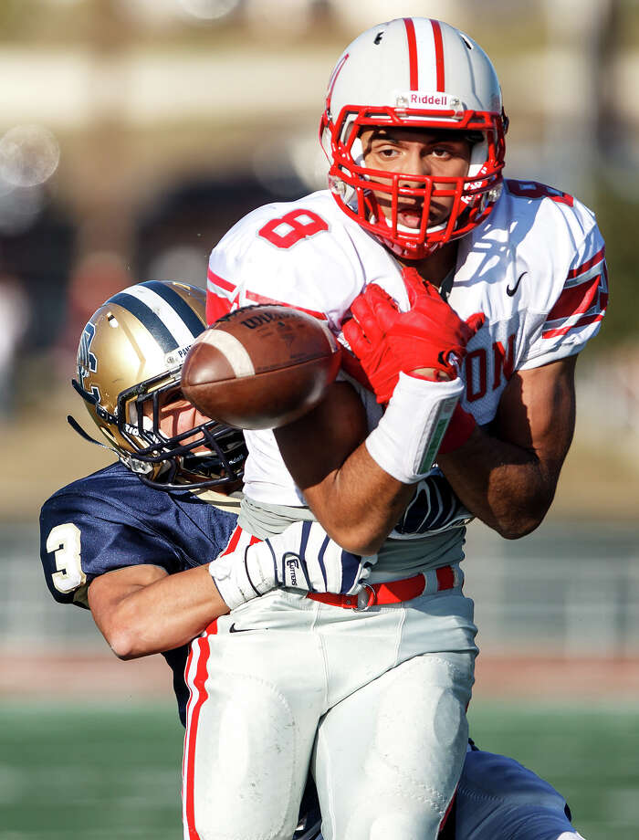 O'Connor's Eddie Vasquez wraps up Judson's Jermaine Adams, preventing him from catching the ball and ending the Rockets' final scoring change during the final minute of their Class 5A Division II second round playoff game at Comalander Stadium on Nov. 24, 2012.  O'Connor held on to come away with a 34-28 victory over the Rockets.  MARVIN PFEIFFER/ mpfeiffer@express-news.net Photo: MARVIN PFEIFFER, Express-News / Express-News 2012