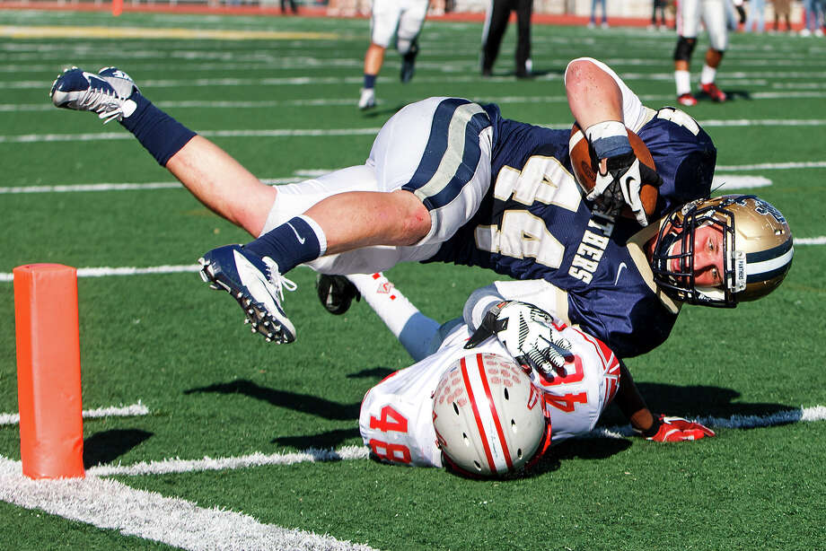 O'Connor's Billy Craft leaps over Judson's Kelvon Ramsey for a touchdown during the third quarter of their Class 5A Division II second round playoff game at Comalander Stadium on Nov. 24, 2012.  O'Connor won the game 34-28.  MARVIN PFEIFFER/ mpfeiffer@express-news.net Photo: MARVIN PFEIFFER, Express-News / Express-News 2012