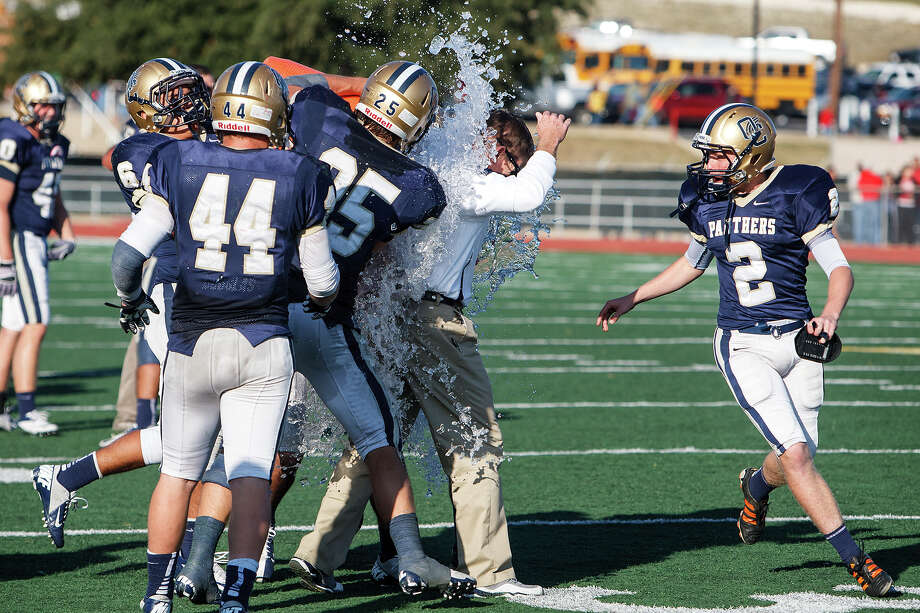O'Connor head coach David Malesky gets a gatorade shower following the Panthers' 34-28 victory over Judson in their Class 5A Division II second round playoff game at Comalander Stadium on Nov. 24, 2012.  MARVIN PFEIFFER/ mpfeiffer@express-news.net Photo: MARVIN PFEIFFER, Express-News / Express-News 2012