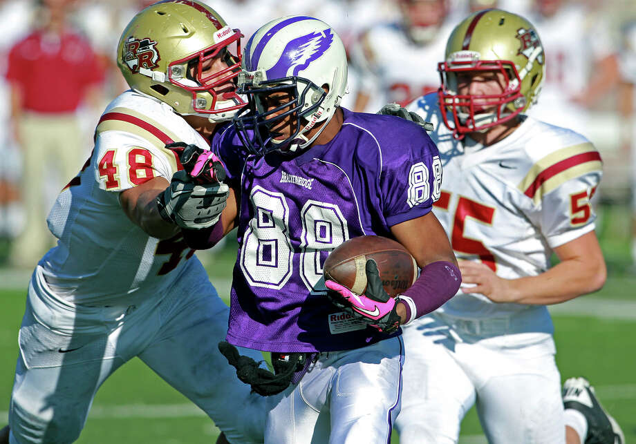 Romonique Anthony tries to evade tacklers in the second half as Brackenridge loses to Leander Rouse 35-14 at Bobcat Stadium in SanMarcos on November 24, 2012. Photo: Tom Reel, Express-News / ©2012 San Antono Express-News