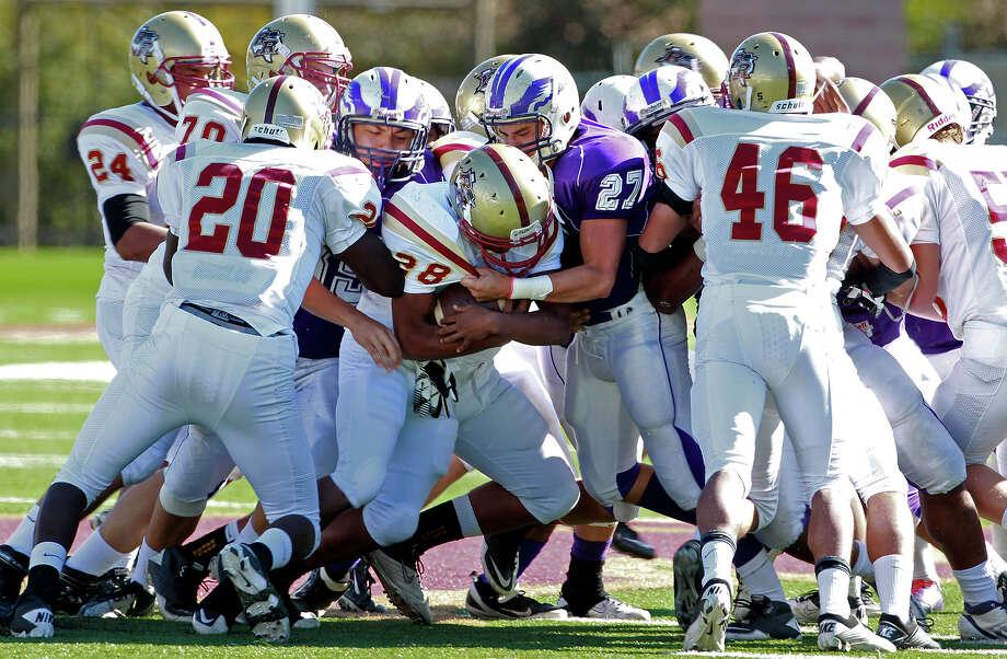 The Eagle defense stops Daniel Dehon as Brackenridge loses to Leander Rouse 35-14 at Bobcat Stadium in SanMarcos on November 24, 2012. Photo: Tom Reel, Express-News / ©2012 San Antono Express-News