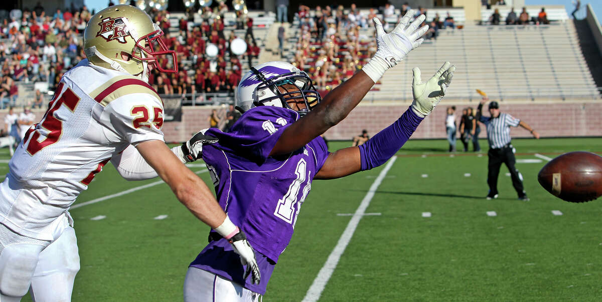 The ref's flag comes out as Montae Whorton is fouled over the back by Dakota Unger on a long pass in the second half as Brackenridge loses to Leander Rouse 35-14 at Bobcat Stadium in SanMarcos on November 24, 2012.