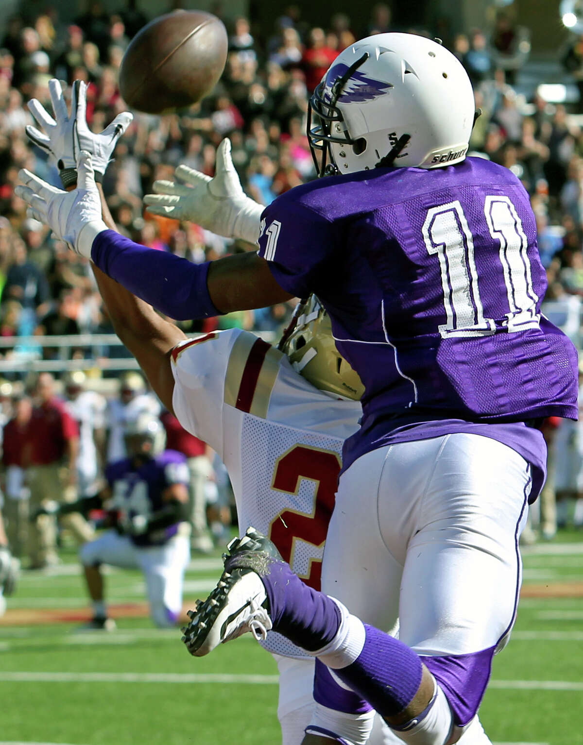 Wide receiver Montae Whorton grabs a touchdown pass over Raider defender Chris Hendricks in the first half as Brackenridge loses to Leander Rouse 35-14 at Bobcat Stadium in SanMarcos on November 24, 2012.