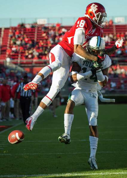 Tulane cornerback Jordan Batiste (14) breaks up a pass intended for Houston wide receiver Mark Rober