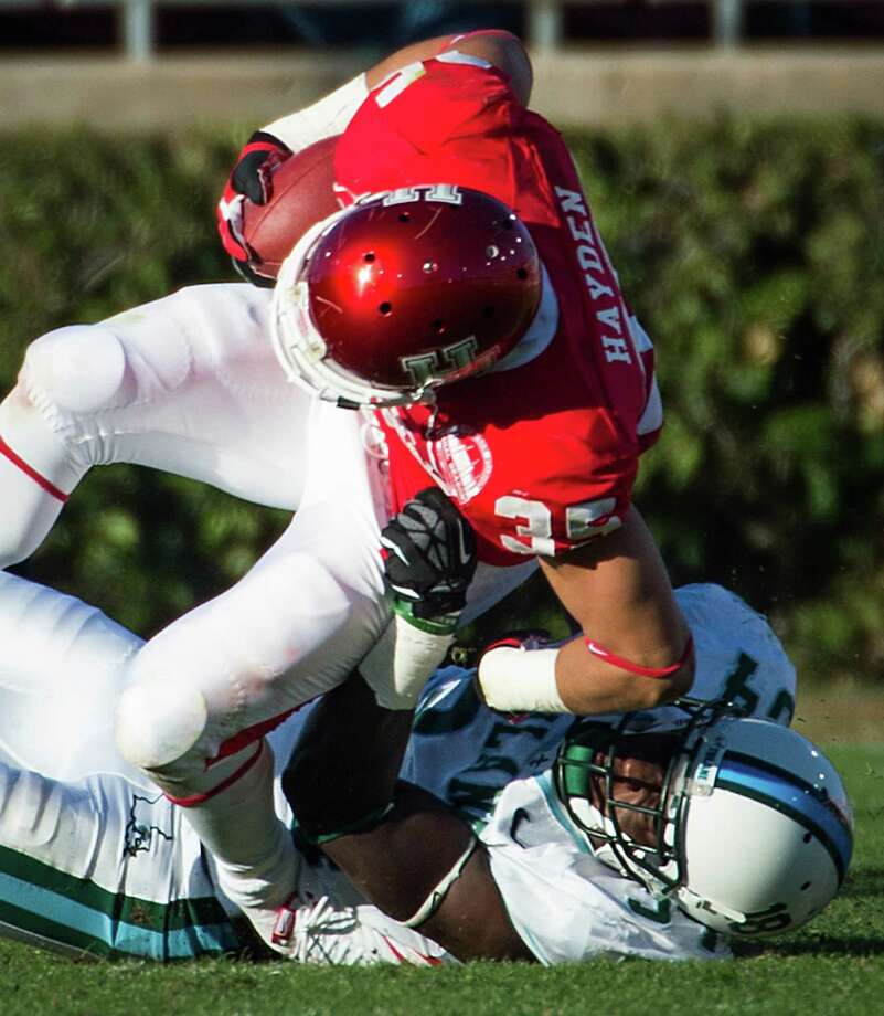 Houston running back Kenneth Farrow (35) has his ankle twisted as he is tackled by Tulane linebacker Darryl Farley (34) during the first half of a college football game at Robertson Stadium, Saturday, Nov. 24, 2012, in Houston. Farrow was injured and left the game after the play. Photo: Smiley N. Pool, Houston Chronicle / © 2012  Houston Chronicle