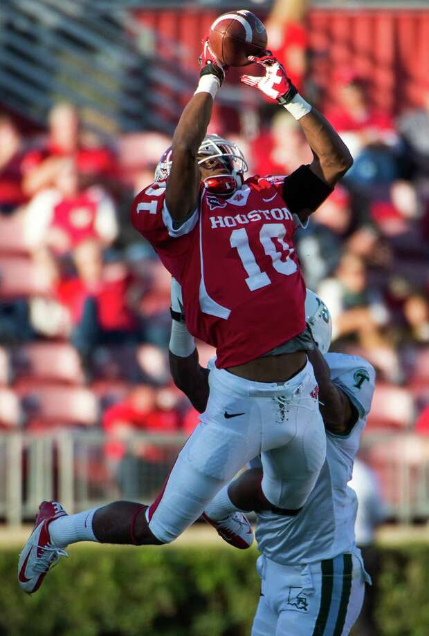 Houston defensive back Zachary McMillian (10) intercepts a pass intended for Tulane wide receiver Ryan Grant (3) during the first half of a college football game at Robertson Stadium, Saturday, Nov. 24, 2012, in Houston. Photo: Smiley N. Pool, Houston Chronicle / © 2012  Houston Chronicle