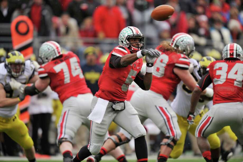 COLUMBUS, OH - NOVEMBER 24:  Quarterback Braxton Miller #5 of the Ohio State Buckeyes completes a pass in the first half against the Michigan Wolverines at Ohio Stadium on November 24, 2012 in Columbus, Ohio. Ohio State defeated Michigan 26-21. Photo: Jamie Sabau, Getty Images / 2012 Getty Images