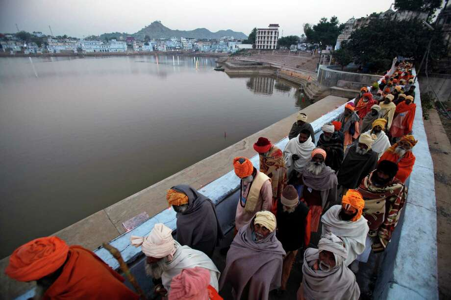 Indian Sadhus, or Hindu holy men, participate in a procession on the banks of the Pushkar Lake during the annual cattle fair in Pushkar, Rajasthan, India.  Pushkar, located on the banks of Pushkar Lake, is a popular Hindu pilgrimage spot that is also frequented by foreign tourists who come to the town for the annual cattle fair and camel races. Photo: Rajesh Kumar Singh, Associated Press / AP