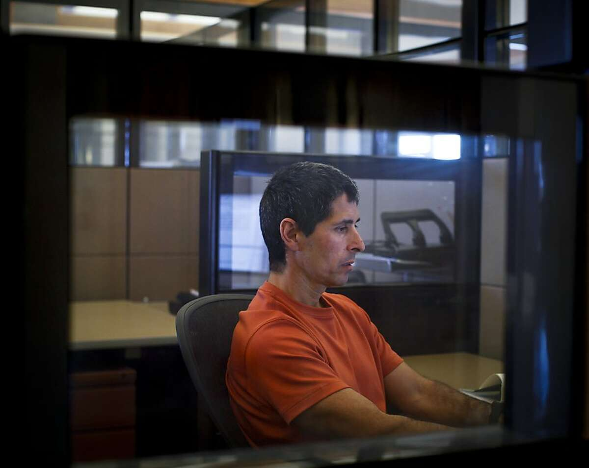 Michael Santos answers emails in his cubicle at Golden State Lumber in Petaluma, Calif., on Tuesday, Sep. 18, 2012. Lee Nobmann, owner of Golden State Lumber, sponsors Santos.