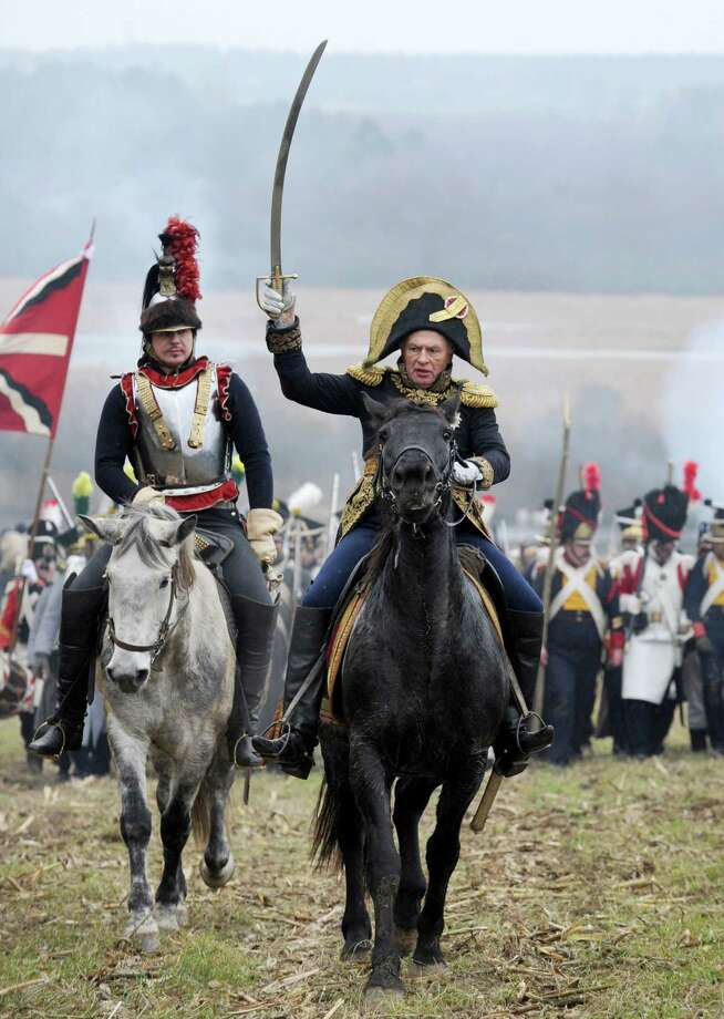 Military history enthusiasts dressed as 1812 French soldiers take part in a staged battle to mark the 200th anniversary of Napoleon's army retreat from Russia across the Berezina River near the village of Studenka, about 85 kilometres from the capital Minsk, on November 24, 2012. Photo: VICTOR DRACHEV, AFP/Getty Images / AFP